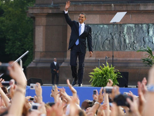 Barack Obama waves after speaking in front of the Victory