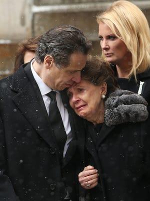 Gov. Andrew Cuomo and his mother, Matilda, watch as the casket of Mario Cuomo departs St. Ignatius Loyola Church.