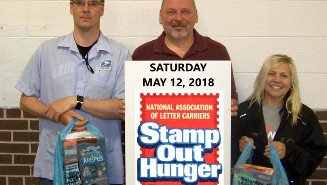Manitowoc and Two Rivers letter carriers will conduct their 26th annual food drive Saturday. Pictured are, from left: Mark Burgard, city carrier of Manitowoc; David Houle, supervisor of delivery for Manitowoc; and Dawn Kaufmann, rural letter carrier of Manitowoc.