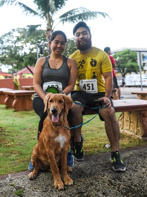 Veronica Brigino and Victor Torres with their dog Milo before the Rotary Club of Guam Sunrise 2K Pet Run/Walk at the Paseo de Susana Park in Hagåtña on June 17, 2017.
