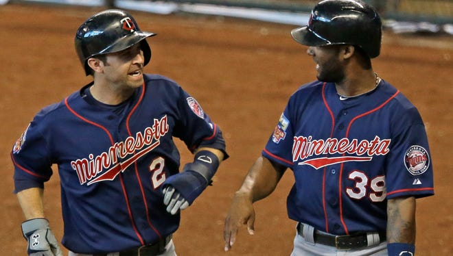 A pair of Twins -- Brian Dozier, left, and Danny Santana -- could be nice values for keeper league owners next season.