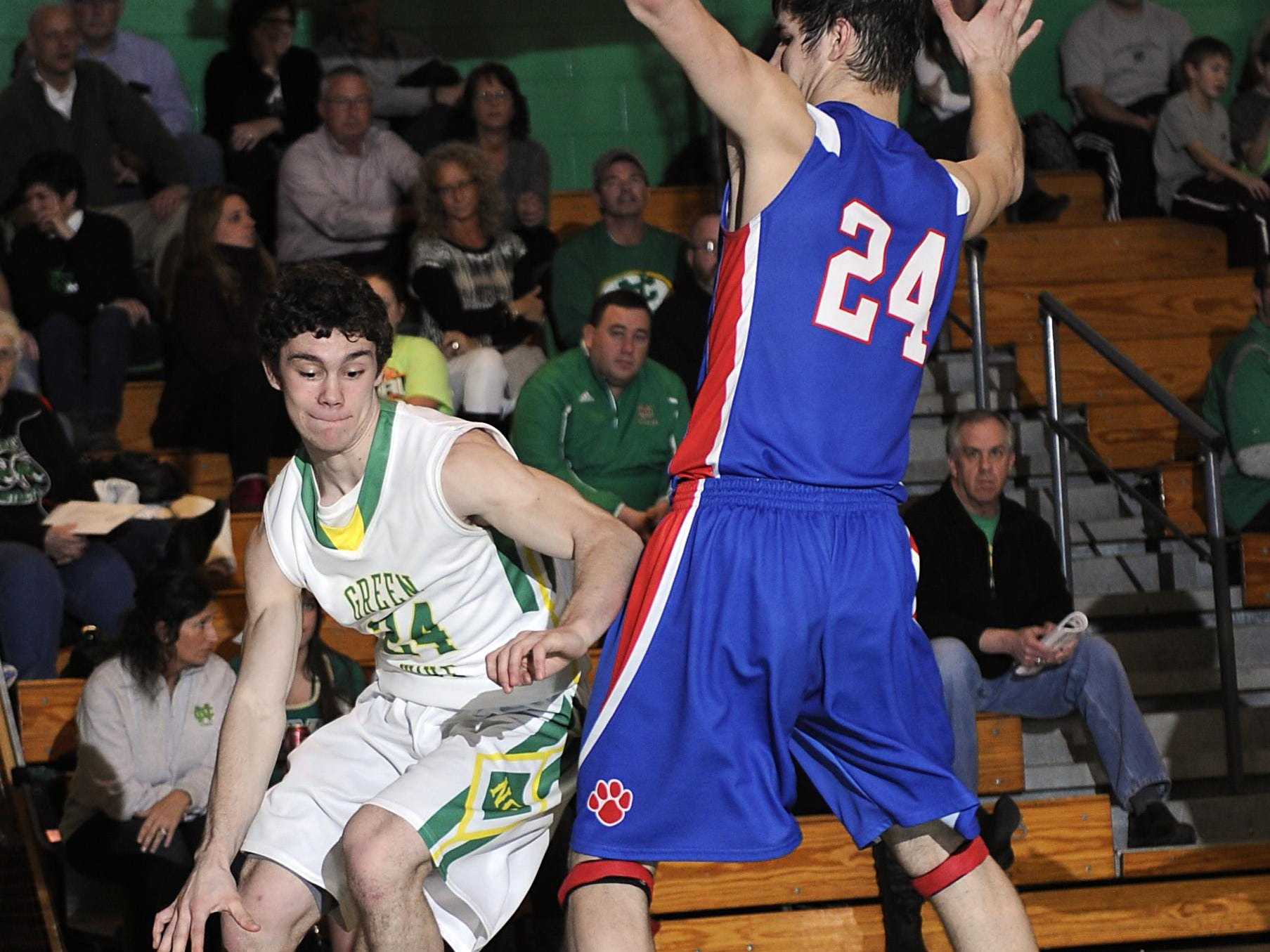 Newark Catholic's Zac Walker dribbles around a Licking Valley defender along the baseline during a 2014-15 game.