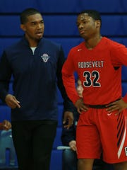 Roosevelt coach Manny Flores instructed Isaiah Nash Friday. Flores played and then coached at Hanks before heading to San Antonio Roosvelt.