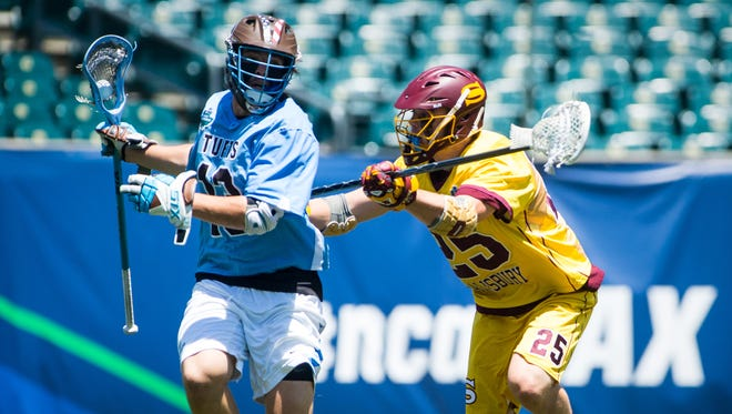 Salisbury University defender Kyle Tucker (25) guards Tufts attackman John Uppgren (13) in the NCAA Divison 3 Finals on Sunday, May 29 at Lincoln Financial Field in Philadelphia, PA.