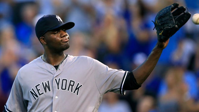 New York Yankees starting pitcher Michael Pineda gets a new ball after giving up his third run in the first inning of a baseball game against the Kansas City Royals at Kauffman Stadium in Kansas City, Mo., Monday, Aug. 29, 2016.