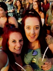 Megan O'Donnell Clements (left) and a friend at the Route 91 Harvest Festival before shots ran out, killing dozens and injuring hundreds of people.