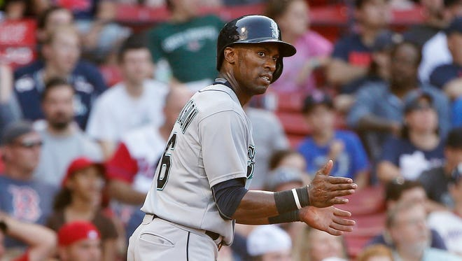 Seattle Mariners' Austin Jackson celebrates after scoring the go-ahead run on a single by Mike Zunino during the 12th inning of a baseball game against the Boston Red Sox in Boston, Sunday, Aug. 16, 2015. The Mariners won 10-8.