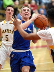 Cedar Crest's Blake Thomson rises for a layup against the Lancaster Mennonite defense Wednesday during the Falcons' 58-56 win in the L-L tournament semifinals.