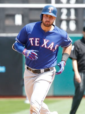 Joey Gallo runs the bases after hitting a solo home run against the Athletics.