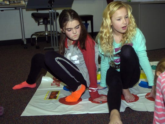 Clair Hallock and Kate Lindsay play a game of Twister.