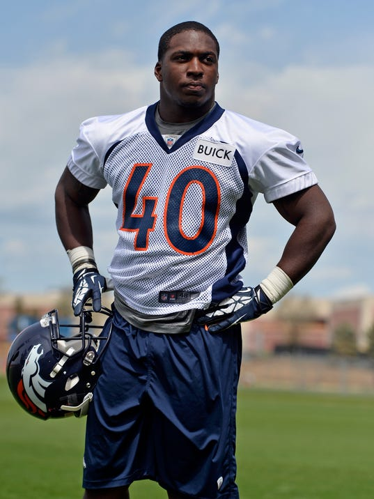Denver Broncos' Juwan Thompson looks on following NFL football rookie camp, Sunday, May 18, 2014, in Englewood, Colo. (AP Photo/Jack Dempsey)