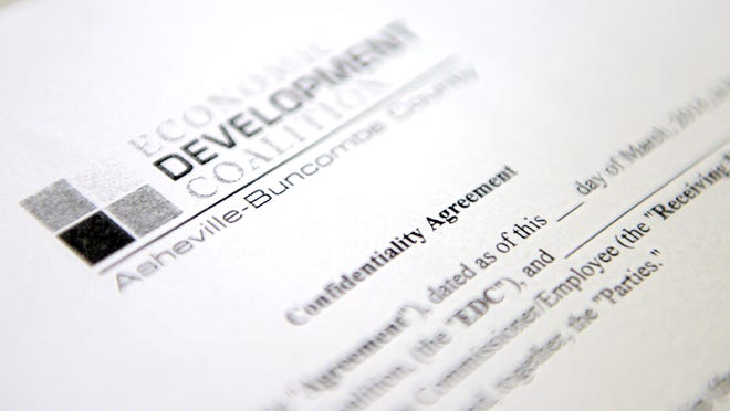 A picture of a confidentiality agreement is written between the Asheville Economic Development Coalition and the Buncombe County Commissioner.