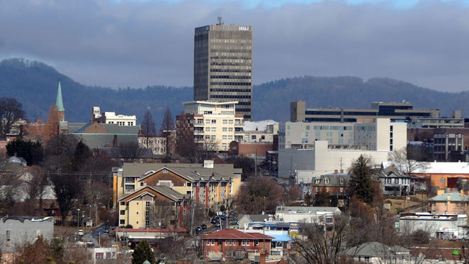 Downtown Asheville breaks free from the clouds Tuesday morning Feb. 17, 2015.