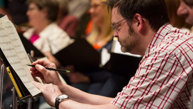 Dusty Molyneaux, trumpet player and director of music education for Great Falls Public Schools, makes notes on his sheet music during a rehearsal with the Great Falls Symphony.