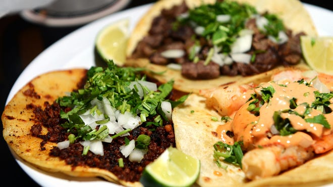 The chorizo, shrimp and carne asado tacos at Tacos Jalisco on Patton Ave.