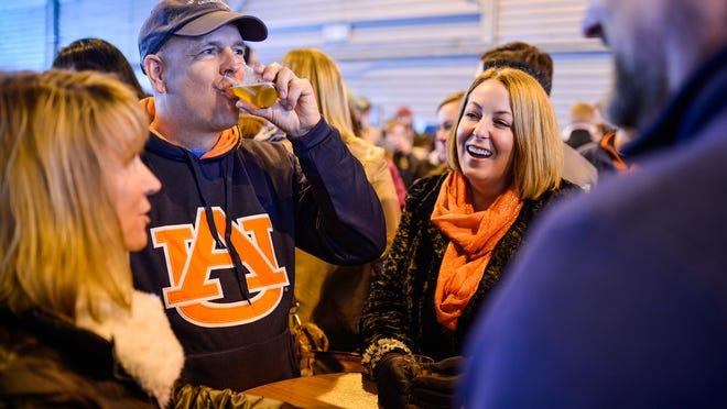 William DeShazer/Special to The Courier-JournalAngie Hofman (left), Jim Gibson, Shauna VanHoose and Clinton Hofman, enjoy each other's company during the Tailspin Ale Fest at Bowman Field. 2015. Angie Hofman, from left, Jim Gibson, Shauna VanHoose, and Clinton Hofman, all of Louisville, enjoy each other's company during the Tailspin Ale Fest at Bowman Field. The festival features 56 breweries from across the country.Saturday Feb. 21, 2015.(By William DeShazer, Special to the C-J)