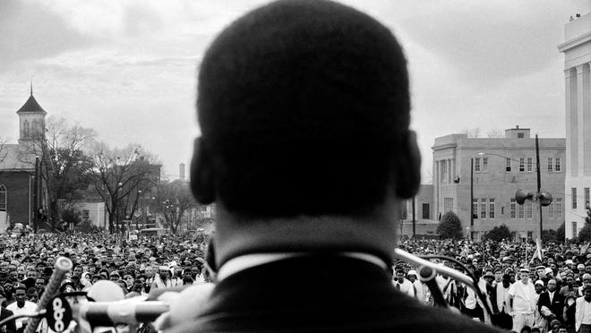 Dr. Martin Luther King Jr. speaks to 25,000 in Montgomery, Ala., on March 25, 1965.