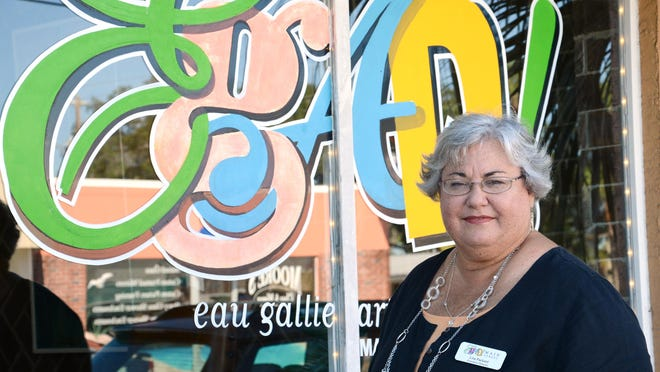 """Lisa Packard, executive director of the Eau Gallie Arts District, says: """"A lot of good stuff is happening here and a lot of good things are coming up. I love it here, I really do."""" She uses her bike to travel everywhere within the district."""
