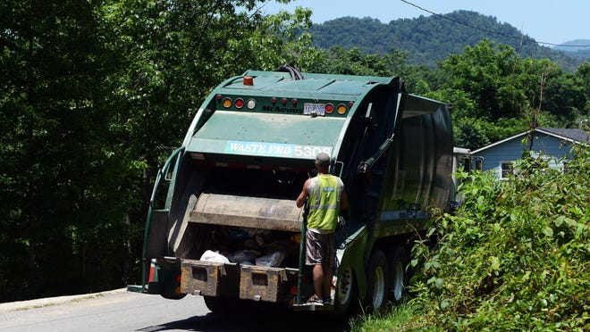 William Woody / wwoody@citizen-times.com Caleb Smith, of Waste Pro, rides on the back of a trash truck as it moves along Jordan Road in Swannanoa on Wednesday afternoon. Caleb Smith of Waste Pro rides on the back of a trash truck along Jordan Road in Swannanoa Wednesday afternoon.