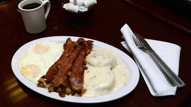 The Big Jack platter with biscuits, gravy, over-medium eggs and bacon at Happy Jacks.