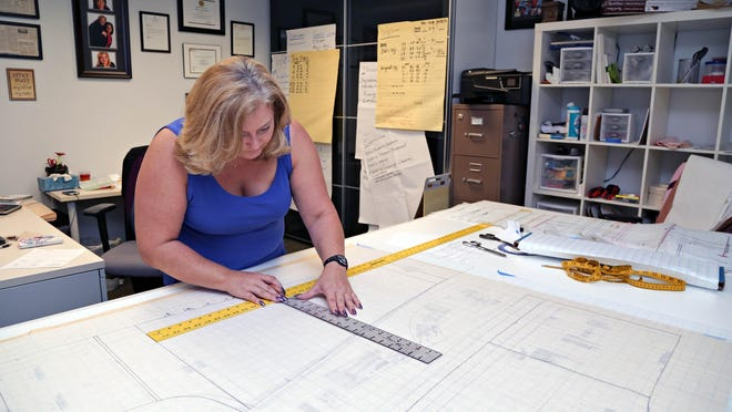 Cherie Fox, a partner in Hildeez Inc., works  on July 20, 2015 on refining a pattern on one of their personal medical products: pants for patients recovering from knee or hip replacement surgery that offer a velco opening for medical personnel to access the incision, as well as a pocket to hold ice packs. Hildeez Inc. works out of the BioInspire offices, which are in a Peoria medical strip mall.