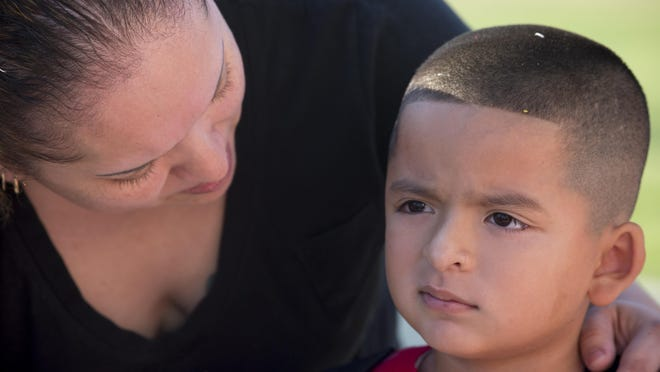 Elizabeth Rodriquez comforts her son, Stephen Gonzales, before his first day of kindergarten last year at Tempe's Kyrene del Norte Elementary School.