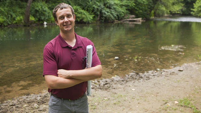 """Trafford McRae, Stormwater Program manager with the city of Waynesboro, stands beside the South River on June 17, 2015. """"Anything we can do to enhance and reconnect the community with the South River we feel is important,"""" said McRae."""