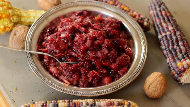 This Oct. 5, 2015 photo shows bacon onion cranberry sauce in Concord, NH. Enhance your cranberry sauce with the one food most people are powerless to resist, bacon. (AP Photo/Matthew Mead)