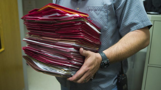 """Captain Mike Martin, commander of Waynesboro police department's Special Operations Division in charge of drug enforcement, shows all of his open case files inside his office on Thursday, Nov. 5, 2015. """"If we arrested everyone that is abusing prescription pills and opiates, we wouldn't have enough hours in the day. The problem is exponential, it feeds on itself,"""" Martin said."""