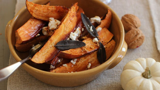 Cider-glazed sweet potatoes with fried sage, garlic and goat cheese make a great side dish for the upcoming holidays.