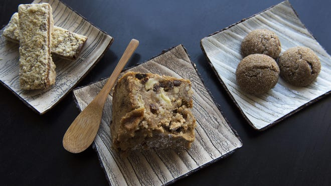 The apple-walnut cake with cinnamon and raisins, caramel crumb bar, left, and smoky cardamom molasses cookie at Yuzu Patisserie.