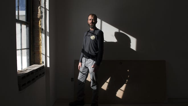 Contractor Sean Perry stands for a picture in a building his team is renovating into apartments on Biltmore Avenue Wednesday Nov. 11, 2015.