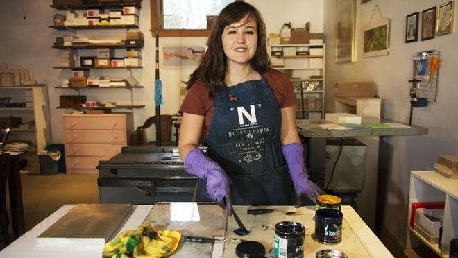 Letterpresser Macon York works with ink and presses in her studio in West Asheville.