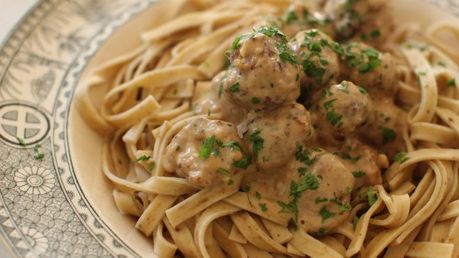 Swedish meatballs are finished in a sauce of broth and cream and can be eaten alone or with pasta.