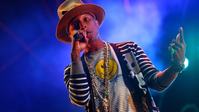 Pharrell Williams performs at the 2014 Coachella Music and Arts Festival on Saturday, April 19, 2014, in Indio, Calif. (Photo by Zach Cordner/Invision/AP) ORG XMIT: CAZC132