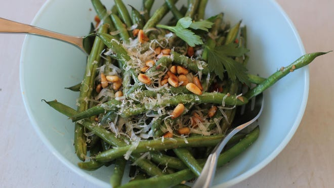 Green beans with anchovies, grated Parmesan and pine nuts.