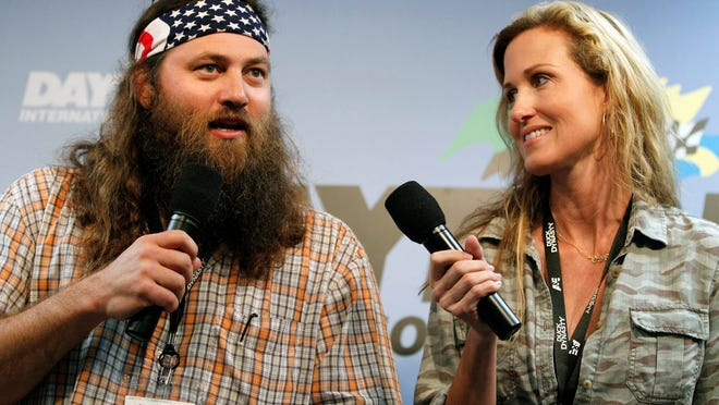 "FILE - This Feb. 24, 2013 file photo shows Willie Robertson, left, and Korie Robertson, of the reality TV show, ""Duck Dynasty"", before the Daytona 500 NASCAR Sprint Cup Series auto race, at Daytona International Speedway in Daytona Beach, Fla. The nominees for this year's Academy of Country Music Awards will be announced via Twitter and Facebook in a series of videos by TV personalities. Fox Sports broadcaster Erin Andrews, Willie and Korie Robertson from ""Duck Dynasty,"" Beth Behrs from ""2 Broke Girls"" and hosts from ""CBS This Morning,"" ''Entertainment Tonight,"" ''The Talk"" and ""The Insider"" will make the announcements on Jan. 29, 2014. (AP Photo/Terry Renna, File) ORG XMIT: CAET394"