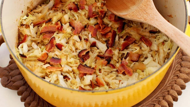Simple beer-braised cabbage is made with bacon. The bacon is crisped up in a large, heavy pot, then some onions are quickly sauteed in a bit of the remaining fat. Then the cabbage is added, along with the beer of your choice, and in 30 minutes you have a dish that may be modest in cost and appearance, but quite grand in flavor.