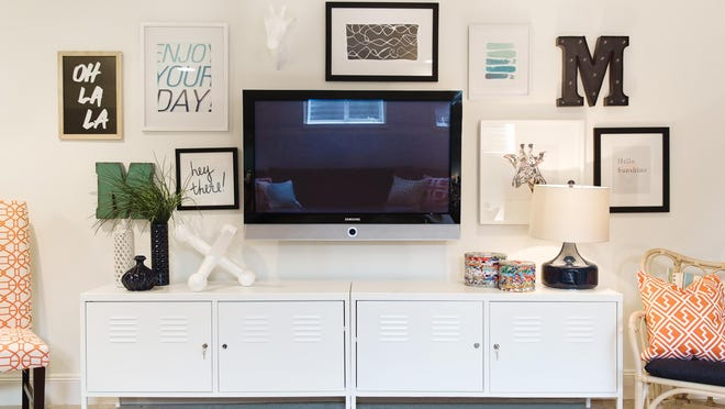 This TV is creatively mounted on the wall which keeps it from standing out too much or detracting from the design of the rest of the room.