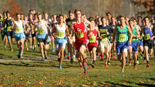 CVU's Tyler Marshall leads at the start of the Division I high school boys state championship cross country race at Thetford Academy in 2015.