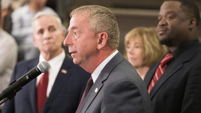 """St. Cloud Mayor David Kleis, center, speaks during a press conference at St. Cloud City Hall, Monday, Sept. 19, 2016. Authorities are treating Saturday's stabbings at Crossroads Mall, as a possible act of terrorism, in part because an Islamic State-run news agency claimed that the attacker was a """"soldier of the Islamic State"""" who had heeded the group's calls for attacks in countries that are part of a U.S.-led anti-IS coalition. (Leila Navidi/Star Tribune via AP)"""