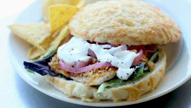 Tortilla crusted tilapia is served with pickled red onions and crema.