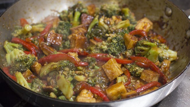 The crispy slices of tofu are a wonderful foil for this recipe's intense chili-orange sauce.