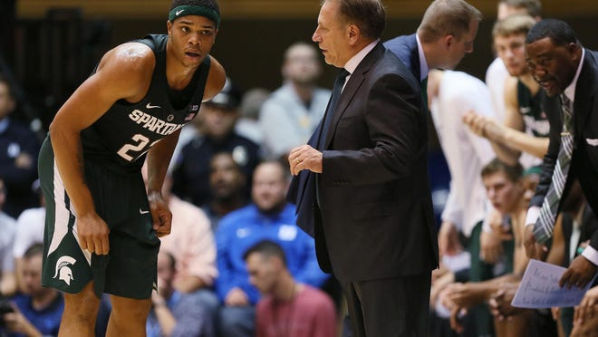 Michigan State coach Tom Izzo talks to Spartans guard Miles Bridges (22) during the first half of their 78-69 loss at Duke on Tuesday in Durham, N.C.