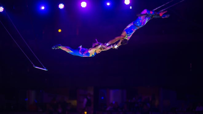 "Trapeze artists in ""Out of this World,"" at Ringling Bros. and Barnum & Bailey Circus"