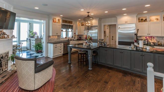 The new kitchen is a modern take on a farmhouse kitchen.