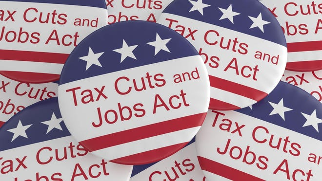 Pile of Tax Cuts And Jobs Act buttons.
