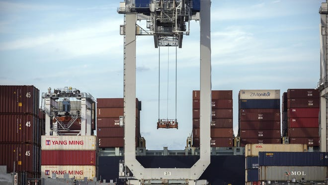 FILE - In this Thursday, July 5, 2018, photo, a ship to shore crane prepares to load a 40-foot shipping container onto a container ship at the Port of Savannah in Savannah, Ga. China's options to retaliate in an escalating trade dispute with Washington go beyond matching U.S. tariff hikes to targeting American companies and government debt. Its state-dominated economy gives regulators tools to hamper sales of engineering, shipping and other services _ an area in which the United States runs a trade surplus _ and to disrupt operations for automakers, restaurant chains and other American businesses in China. (AP Photo/Stephen B. Morton, File)