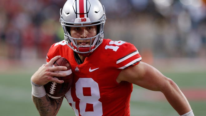 In this Sept. 22, 2018, file photo, Ohio State quarterback Tate Martell runs against Tulane during an NCAA college football game in Columbus, Ohio. Martell says he is transferring from Ohio State to Miami.