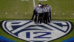 Dec 6, 2019; Santa Clara, CA, USA; Referees gather at mid field during the first half of the Pac-12 Conference championship game between the Utah Utes and the Oregon Ducks at Levi's Stadium. Mandatory Credit: Kirby Lee-USA TODAY Sports